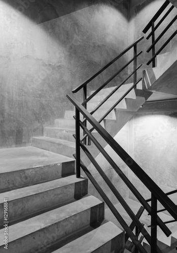 Canvas Prints Stairs Empty modern rough concrete stairway with black steel handrail