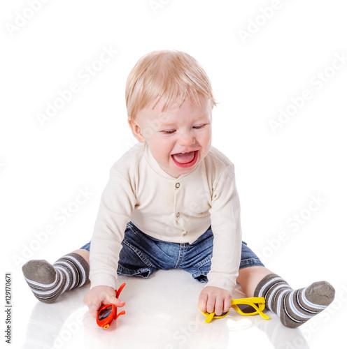 Fotografia, Obraz  capricious boy sitting