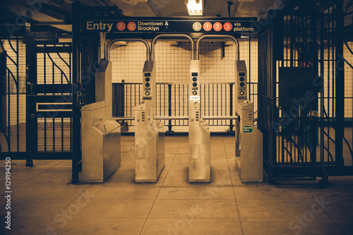 фотография  Vintage tone New York City subway turnstile