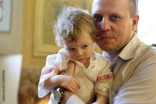 Valokuva  Father with son in church