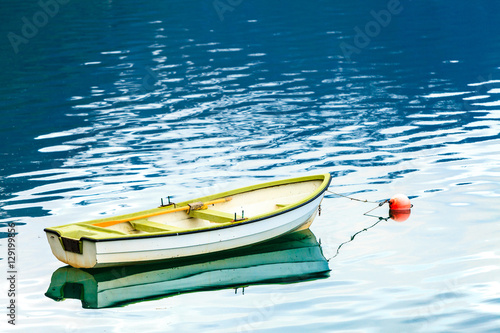 Foto  Little boat on water surface