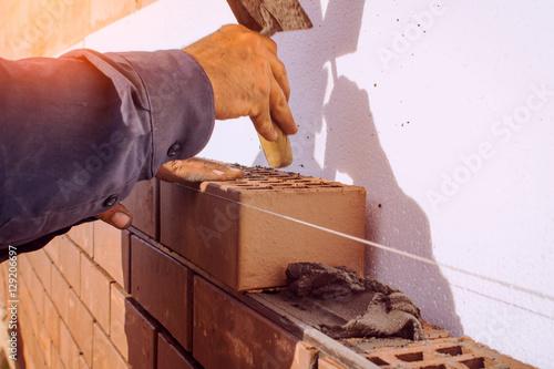 Facing bricklaying construction work, manual labor.
