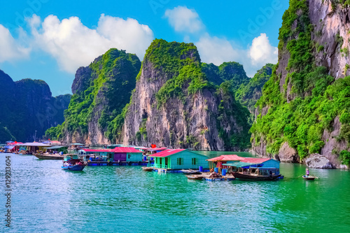 Stampa su Tela Floating fishing village rock island in Halong Bay Vietnam, Southeast Asia
