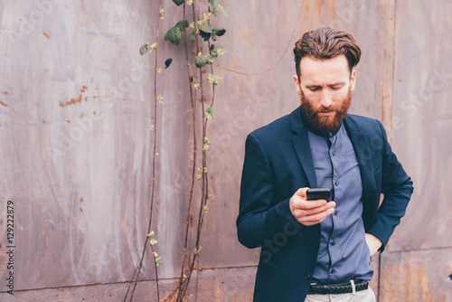 Man using smartphone while standing outdoors