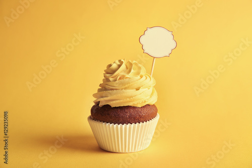 Birthday cupcake with space for text on yellow background Wallpaper Mural