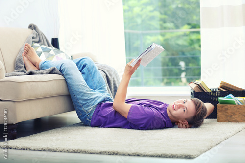 Deurstickers Ontspanning Young handsome man reading book at home