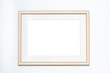 Blank picture frame on white wall background