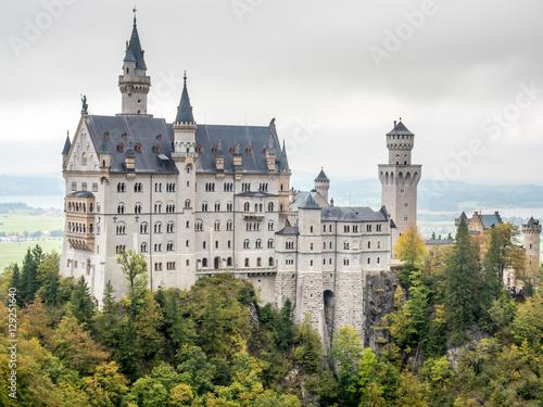 Montage in der Fensternische Schloss Neuschwanstein castle under cloudy sky