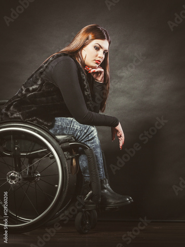 Foto Sad girl on wheelchair