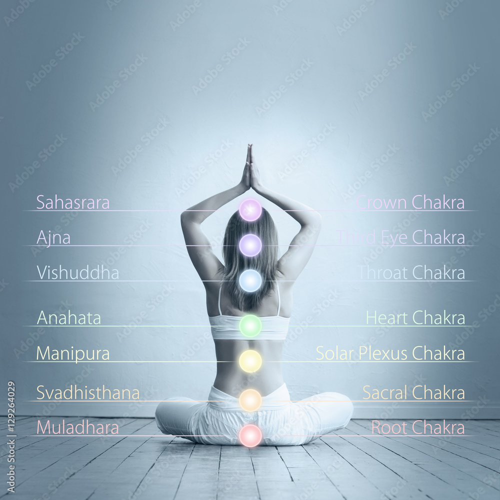 Photo & Art Print Young woman meditating in a lotus position