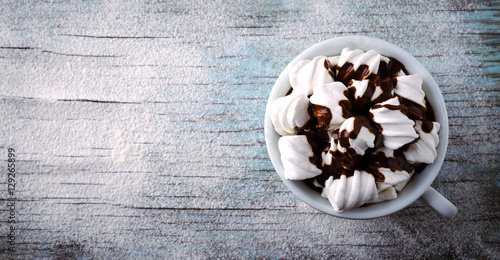 Foto op Plexiglas Chocolade Cup of hot chocolate with marshmallows on snowy table, Christmas, New Year, Winter background