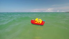 Toy Ship Boat On The Sea Waves. Conceptual Design.