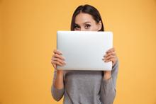 Model Hiding Behind Laptop