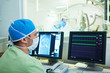 Interventional cardiology. Male surgeon doctor at operation