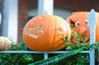 Scary Halloween pumpkin face impaled on fence