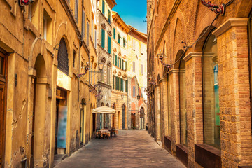 Fototapeta Narrow old street in medieval Siena, Tuscany, Italy.