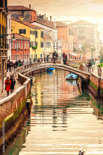 Wall Murals Central Europe Narrow canal in beautiful Venice at sunset, Italy.