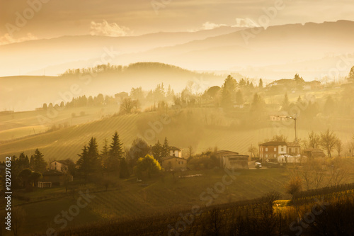 Poster Morning with fog Beautiful landscape with hills at sunset in Emilia-Romagna region, Italy.
