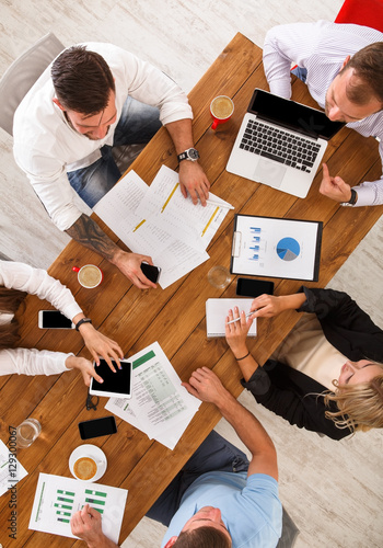 Obraz Group of busy business people working in office, top view - fototapety do salonu