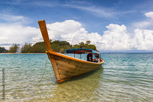 Fototapety, obrazy: Fisherman boat float in blue sea with white sand beach and beaut