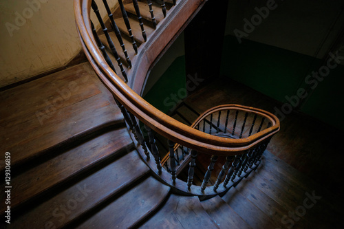 Shape, architecture and perspective. Beautiful old wooden spiral staircase.