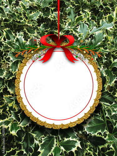 blank round decorated ornament frame hanged by red christmas ribbon against green butchers broom background - Christmas Broom Decoration
