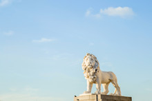 Sunny Lion Statue On The Blue Sky Background. The South Bank Lion, Also Known As The Coade Stone Lion At The South Bank, Westminster Bridge.