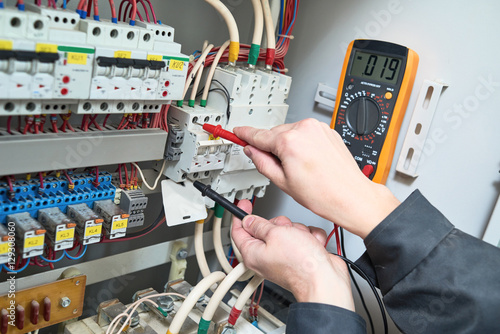 Fotomural electrician measurements with multimeter tester