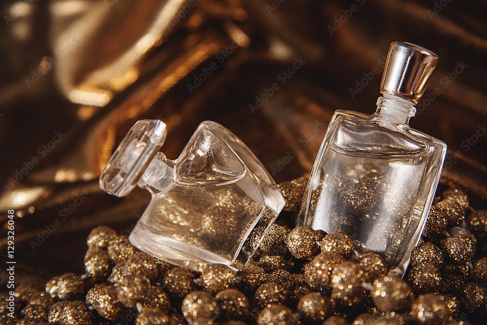 Fototapety, obrazy: Bottle of woman perfume on gold background.