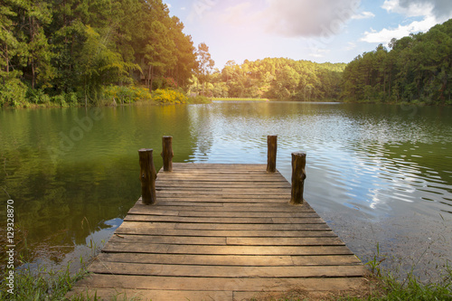 beautiful scenery - wooden dock beside lake. Fototapet