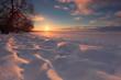 Winter sunrise background. Sun touch horizon. Sunlight illuminat
