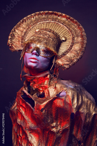 Female model in round headwear - Buy this stock photo and explore
