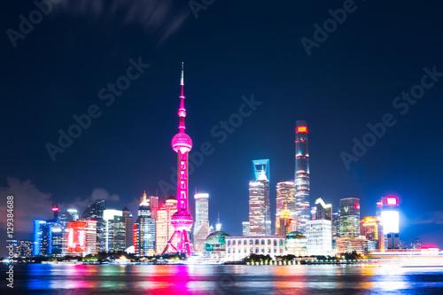 Foto op Aluminium Shanghai modern office buildings near illuminated orient pearl tower by r