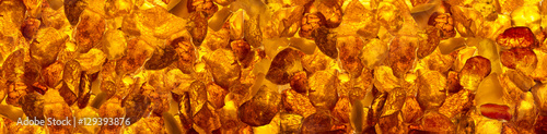 Canvas panoramic closeup baltic amber stones rectangular lie on a flat surface