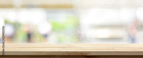 Obraz Wood table top on blur kitchen window background, panoramic banner - fototapety do salonu