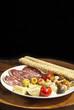 piatto salame nostrano, grissini, carciofi, funghi, olive