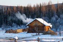 Winter House With A Furnace And Firewood