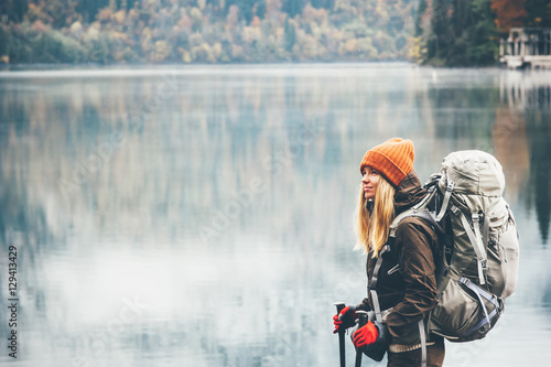 Woman with backpack hiking Lifestyle adventure concept forest and lake on backgr Wallpaper Mural