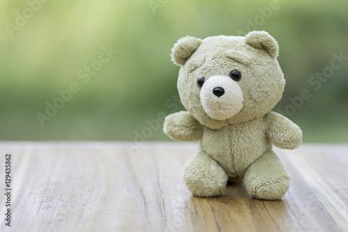Brown teddy bear on wooden floor