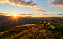A Hiker Camping On The Mountain Summit Of Place Fell In The Lake District. UK