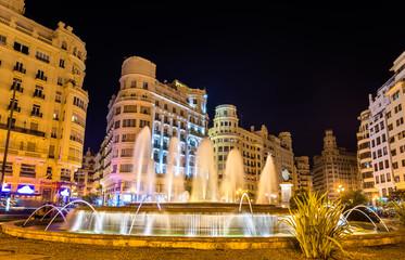 Fototapeta na wymiar Fountain on the Plaza del Ayuntamiento of Valencia - Spain