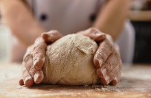 Close-up Of Chef Hands Kneadin...