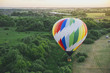 Balloon on a background of the beautiful green landscape