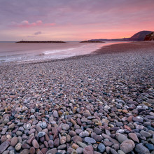 Colorful Sunset On The Shores Of The English Channel. Pebble Beach. Sidmouth. Devon. England