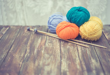 Yarn With Knitting Needles On Wooden Background