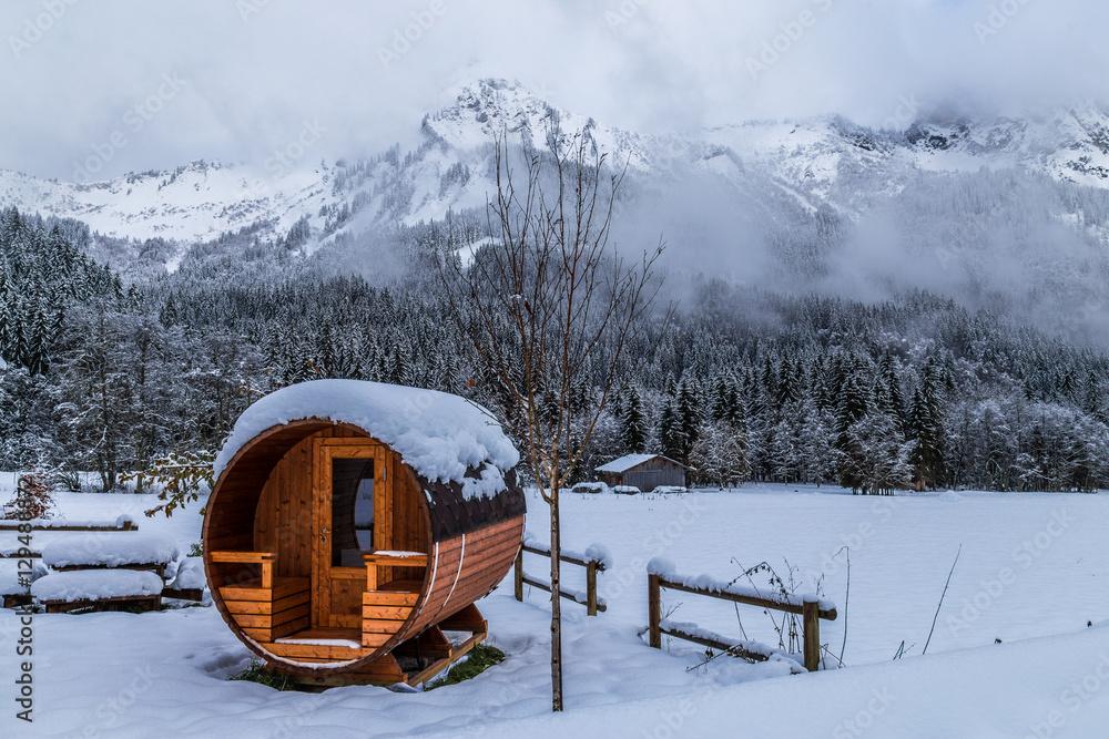 Fototapeta Wooden sauna in a snowy landscape