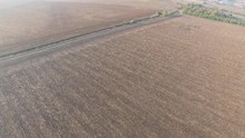 Flying High Above The Arable Land With Country Road