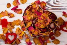 Heart-shaped Box With Rose Potpourri. Chestnuts, Dried Petals And Hearts. Design On Day Of Love.