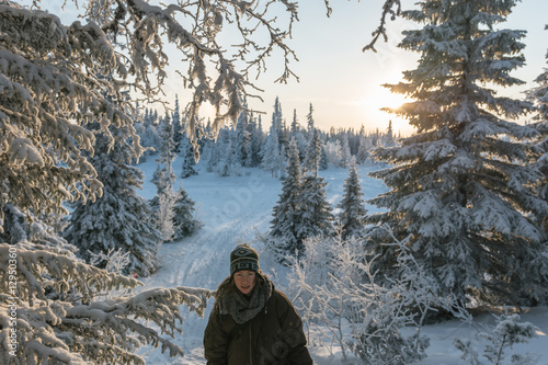 Fotobehang Fantasie Landschap cute woman in snowy frozen landscape