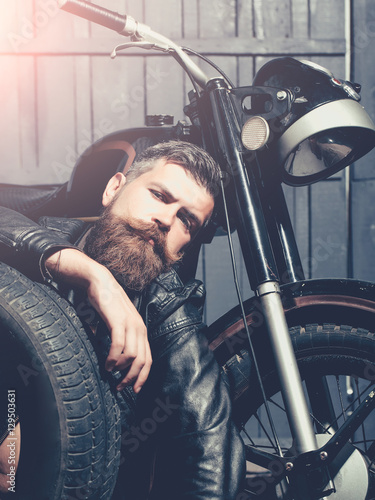 фотография  Bearded man hipster biker